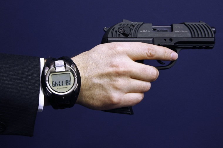 A man holds a prototype of a smart gun by Armatix during the International Guns Exhibition Nuremberg, March 13, 2009.