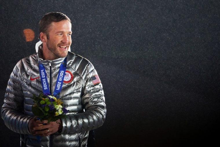 Joint bronze medalist Bode Miller of the United States celebrates on the podium, Feb. 16, 2014.