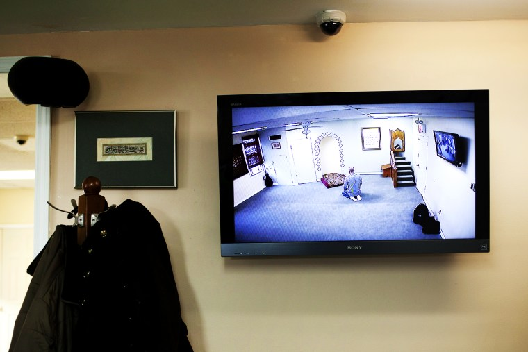 A CCTV monitor displays a man praying at the Iqra Masjid in Brooklyn, New York, Feb. 25, 2012.