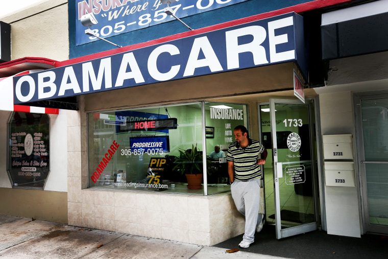 Baseel Farah walks out of Leading Insurance Agency as the insurance agency helps enroll people in health insurance plans under the Affordable Care Act in Miami, Feb. 13, 2014.