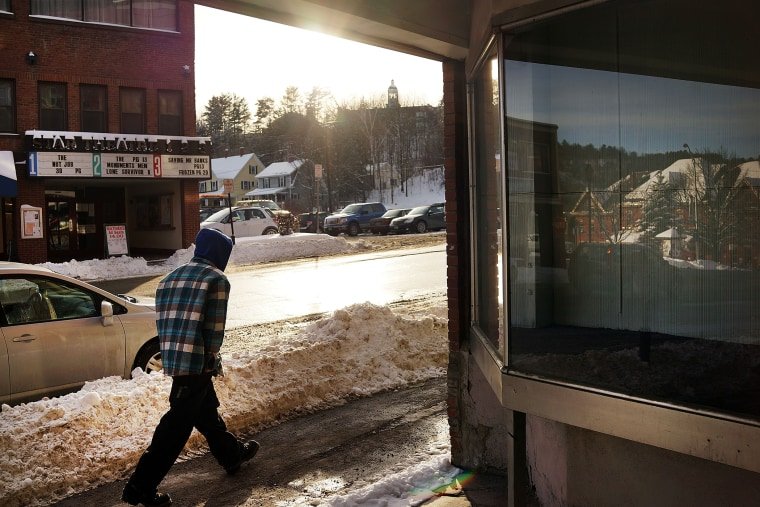 A man walks down a street in St. Johnsbury, a town which has a high rate of heroin users, on Feb. 6, 2014 in St. Johnsbury, Vermont.