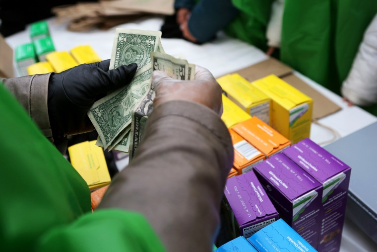 Girl Scouts sell cookies in New York, Feb. 8, 2013.