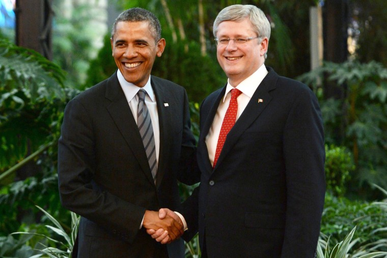 Canada's Prime Minister Stephen Harper shakes hands with President Barack Obama during the North American Leaders Summit in Toluca, Mexico,Feb. 19, 2014.