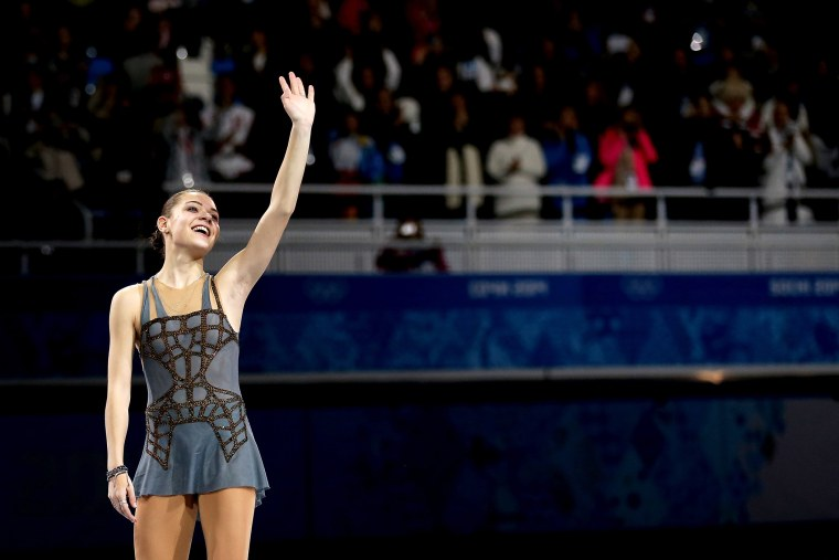 Gold medalist Adelina Sotnikova of Russia celebrates on the podium during the flower ceremony for the Ladies' Figure Skating, Feb. 20, 2014.
