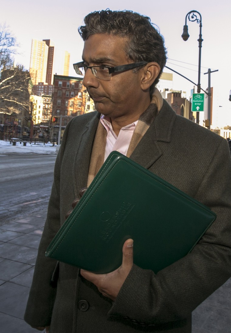 Conservative commentator, Dinesh D'Souza exits the Manhattan Federal Courthouse in New York, January 24, 2014.