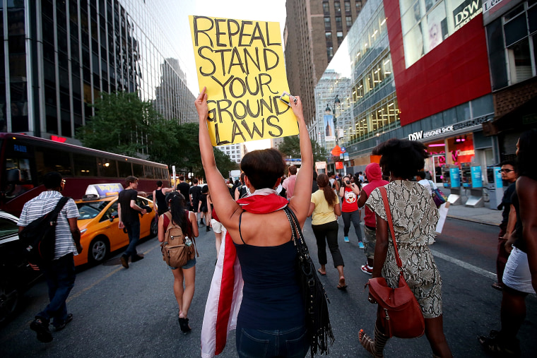 People march through the street after a rally for Trayvon Martin, July 14, 2013, in New York, N.Y.
