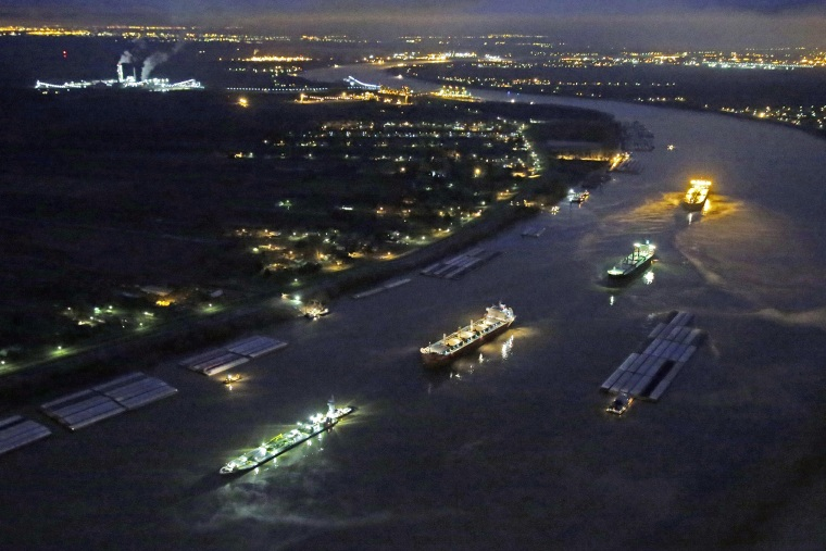 River traffic is halted along the Mississippi River between New Orleans and Vacherie, La., due to a barge leaking oil in St. James Parish, La., Feb. 23, 2014.