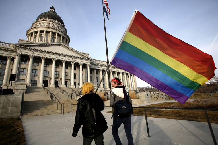 Corbin Aoyagi (L) and Jerusha Cobb walk to join supporters of same-sex marriage rally at Utah's State Capitol building in Salt Lake City, Utah on Jan. 28, 2014.