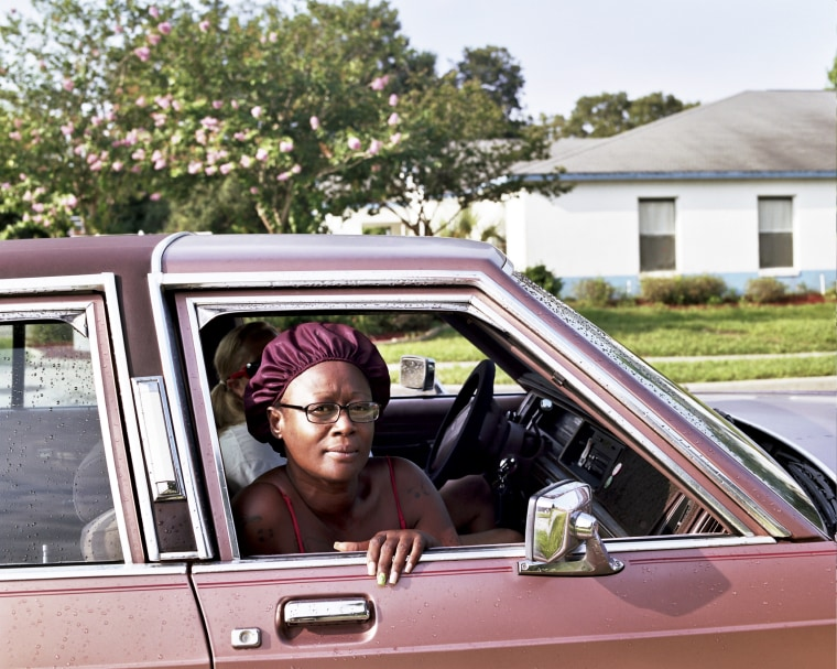 Mary Fudge in the passenger seat, on 13th Street, June, 2013.