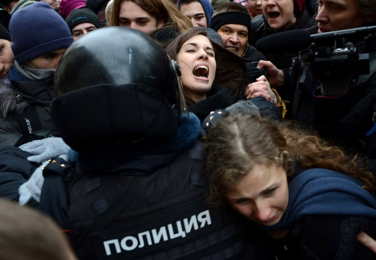 Nadezhda Tolokonnikova (rear) and Maria Alyokhina (front) are taken into custody by Russian police during a protest on Feb. 24, 2014.