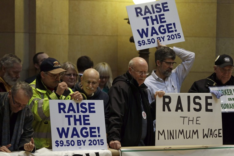 Demonstrators rally at the state Capitol, calling for lawmakers to raise the minimum wage, February 25, 2014, in St. Paul, Minn.