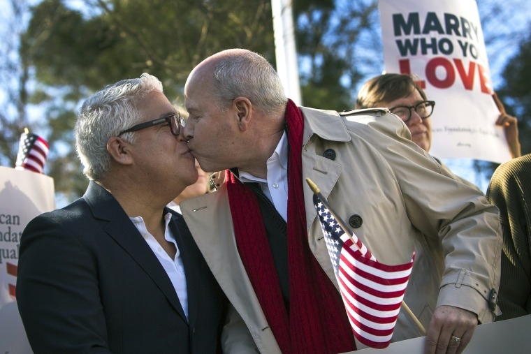 Robert Roman and Claus Ihlemann, of Virginia Beach, celebrate a ruling that declared Virginia's same-sex marriage ban unconstitutional on Feb. 14, 2014, in Norfolk, Va.