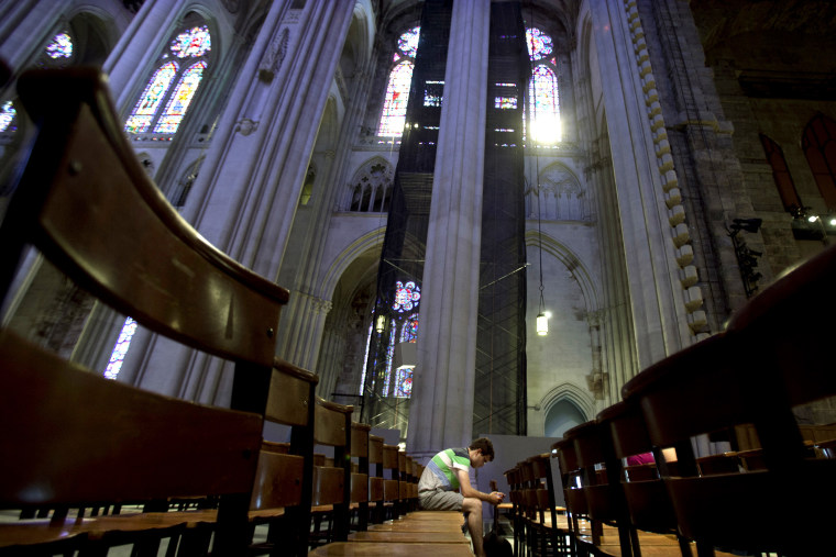 A man sits in the pews of Cathedral of St. John the Divine in New York, June 25, 2013.