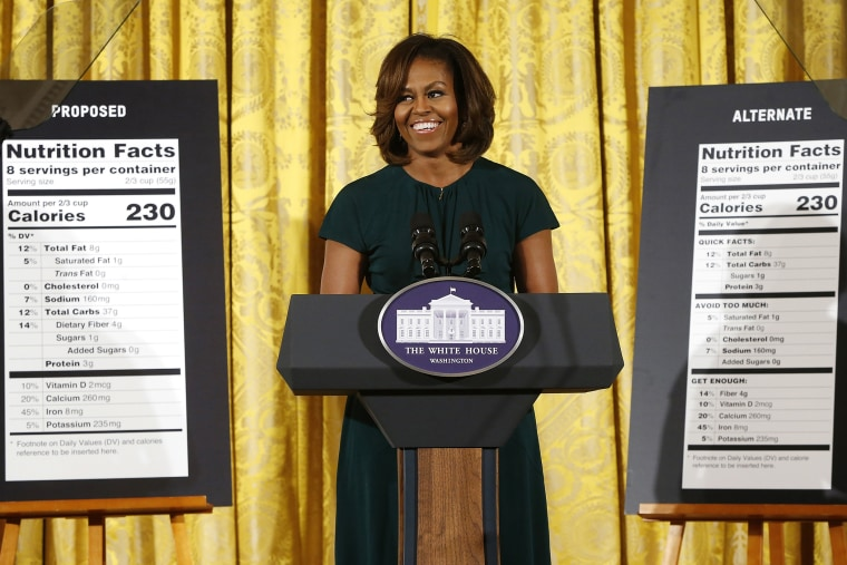 U.S. first lady Michelle Obama smiles as she unveils proposed updates to nutrition facts labels, Feb. 27, 2014.