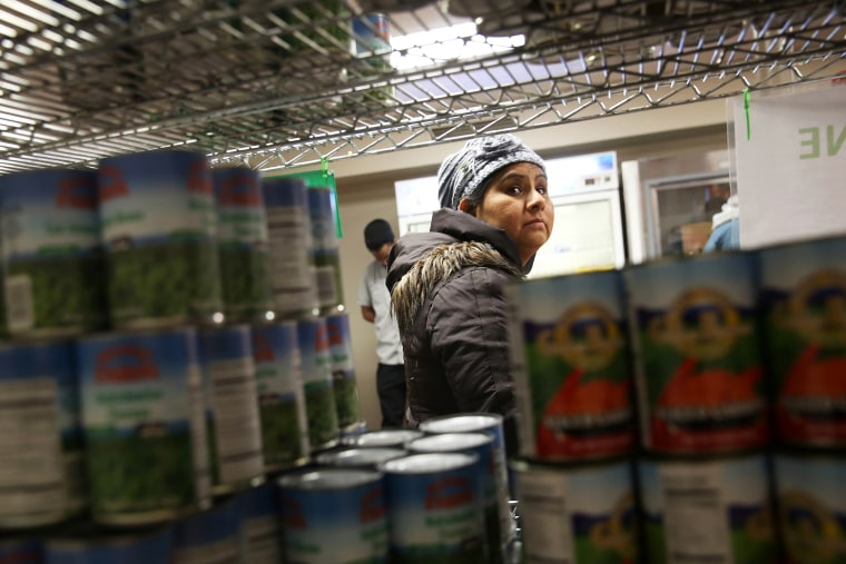 A Harlem resident chooses free groceries at the Food Bank For New York City, Dec. 11, 2013.