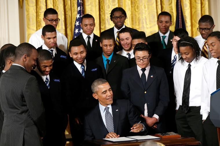 U.S. President Barack Obama signs an executive memorandum regarding the My Brother's Keeper Initiative, Feb. 27, 2014.