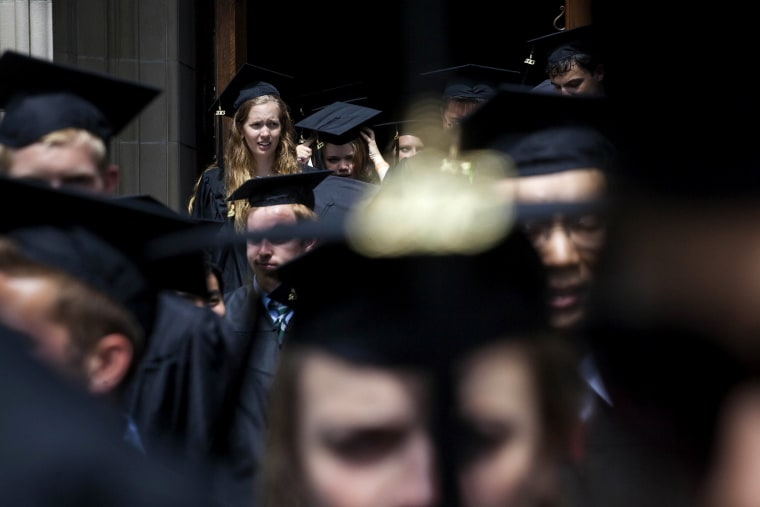 New graduates walk out of the chapel after their commencement at Princeton University in Princeton, New Jersey, U.S., on June 2, 2013.
