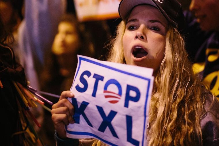 Protestors in Santa Monica urge President Obama to reject the Keystone KXL Pipeline, Feb. 3, 2014.
