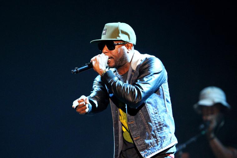 Talib Kweli performing at The Arena at Gwinnett Center, Nov. 22, 2013, in Atlanta.