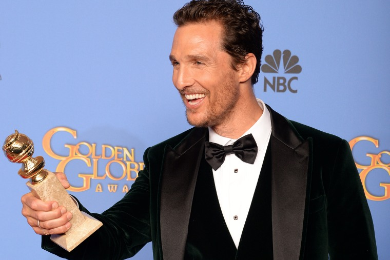 """Actor Matthew McConaughey celebrates winning Best Actor in a Motion Picture - Drama for """"Dallas Buyers Club"""" in the press room during the 71st Annual Golden Globe Awards in Beverly Hills, Calif., January 12, 2014."""