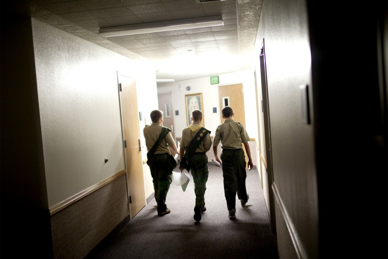 Boy scouts walk through the empty halls of a meeting house of the Church of Jesus Christ of Latter-day Saints, in Cedar Hills, Utah, Oct. 11, 2012.