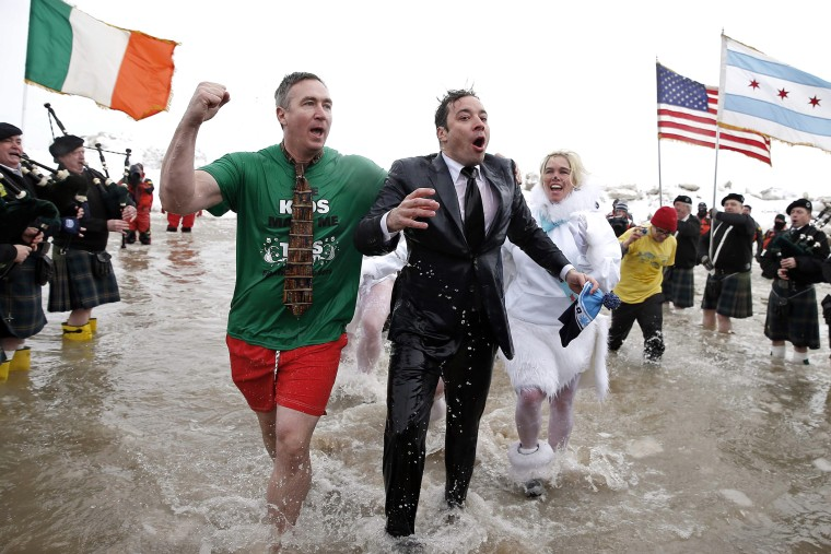 """The Tonight Show"" host Jimmy Fallon (C) emerges from the waters of Lake Michigan as he takes part in the Annual Polar Plunge in Chicago, March 2, 2014."