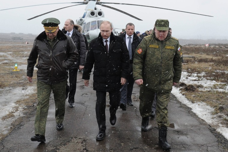Russian President Vladimir Putin arrives to watch a military exercise near St.Petersburg, Russia, March 3, 2014.