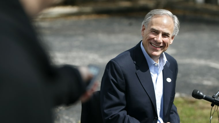 Texas Attorney General Greg Abbott speaks to the press after voting in the Texas primary in Austin, March 4, 2014.