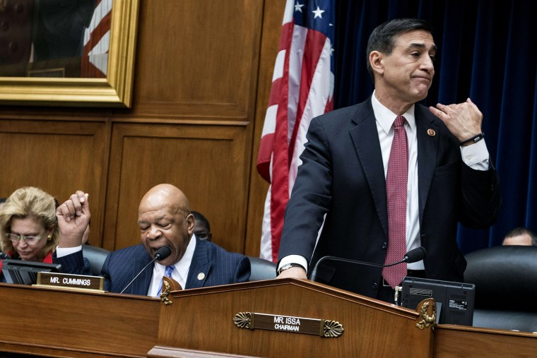Committee chairman Rep. Darrell Issa (R-OH) (R) cuts ranking member Rep. Elijah Cummings (D-MD) off during a hearing of the House Oversight and Government Reform Committee on Capitol Hill on March 5, 2014 in Washington, DC.