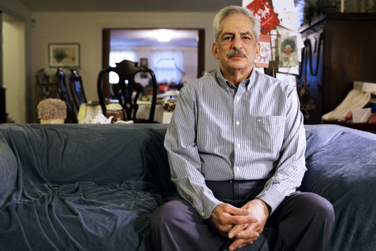 Stan Osnowitz, who lost his state unemployment benefits of $430 a week, poses in his living room in Baltimore, Jan. 10, 2014.