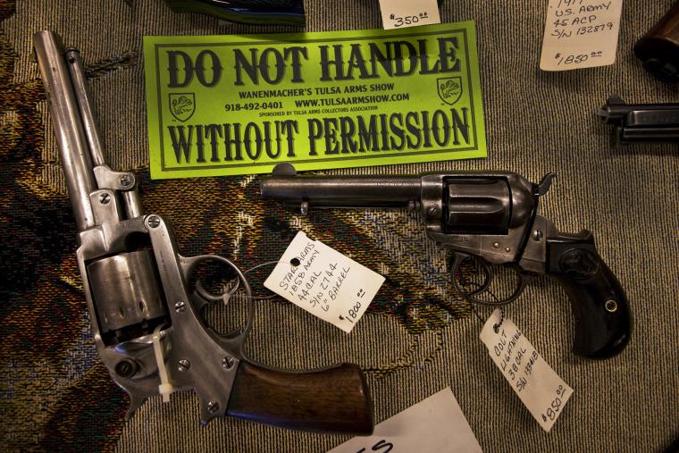 Guns are displayed for sale at a gun show near Wichita, Kansas.
