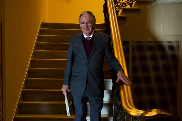 Sen. Tom Harkin descends a stairway to the first floor of the Capitol after the senate luncheons.