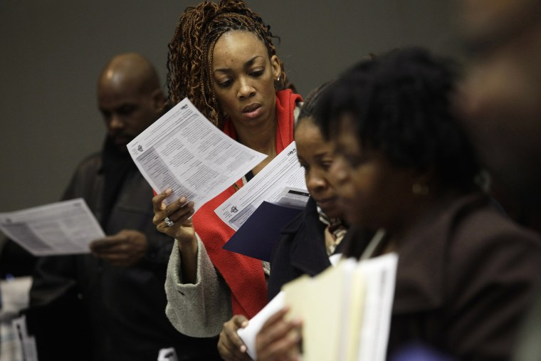 People attend a job fair in Detroit, Michigan, Mar. 1, 2014.