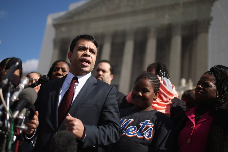 NAACP Legal Defense and Educational Fund Special Council Debo Adegbile talks to reporters outside of the U.S. Supreme Court February 27, 2013.