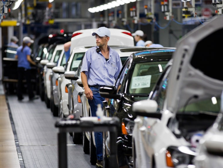 In this July 31, 2012 file photo, an employee at the Volkswagen plant in Chattanooga, Tenn., works on a Passat sedan.