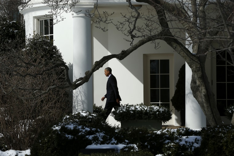 President Barack Obama walks from the Oval Office in Washington, March 5, 2014.