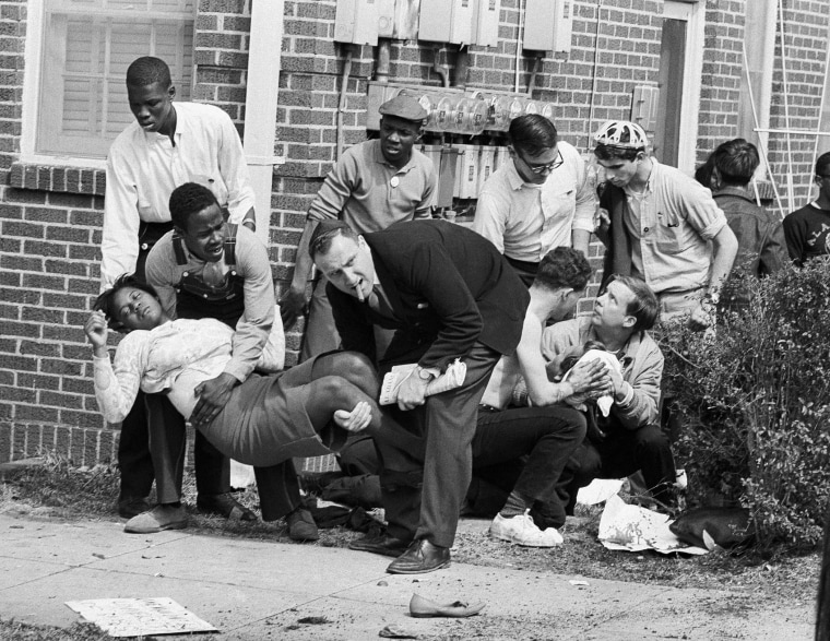 Mrs. S.W. Boynton is aided by two men after she was injured when state police broke up a demonstration march in Selma, Ala. on Bloody Sunday, March 7, 1965.