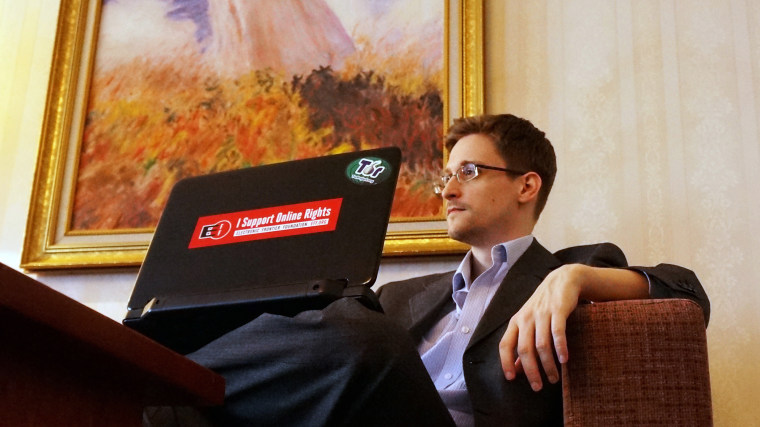 Former intelligence contractor Edward Snowden poses for a photo during an interview in an undisclosed location in Moscow, Dec. 2013.