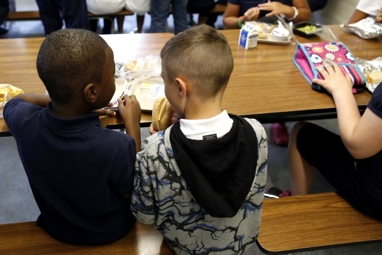 Children eat lunch at Roger Clap Innovation School in Dorchester, Mass., on Aug. 30, 2013