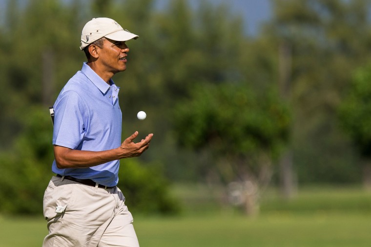 President Barack Obama walks on the second hole green at the Kaneohe Klipper Golf Course at Marine Corps Base Hawaii on January 2, 2014 in Kaneohe, Hawaii.