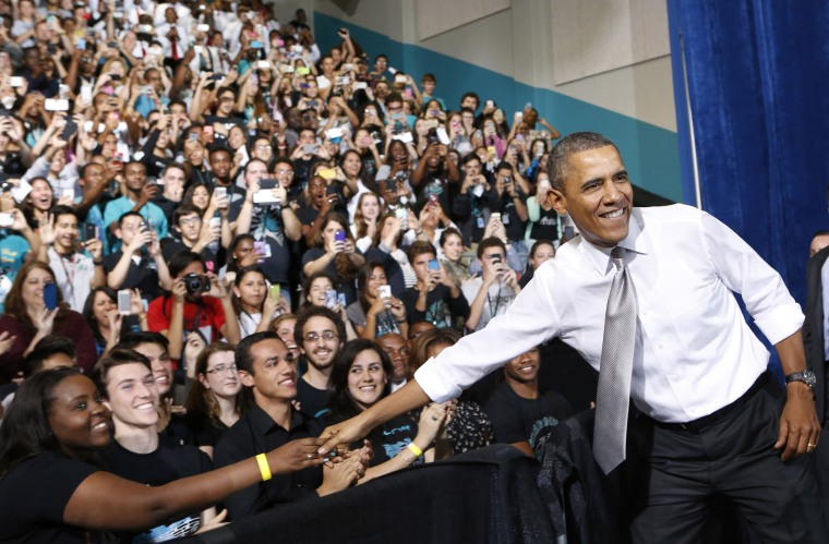 President Barack Obama is greeted by students at the Coral Reef High School in Miami, Florida, March 7, 2014.