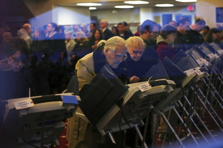 Voters cast ballots inside a polling station at Cross Community Church in Elyria, Ohio, on Election Day, Nov. 6, 2012.