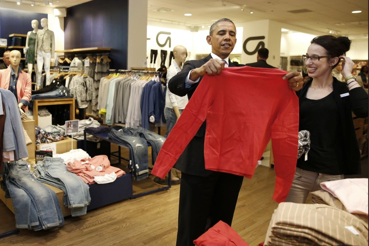 President Barack Obama looks for gifts for his family with salesperson Susan Panariello after stopping off at a GAP store in New York on March 11, 2014.