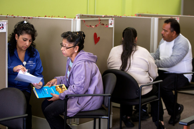Jesica Arias, meets with clients at AltaMed Resource Center to guide them through applying for insurance under the Affordable Care Act in Commerce, Calif., Jan. 30, 2014.