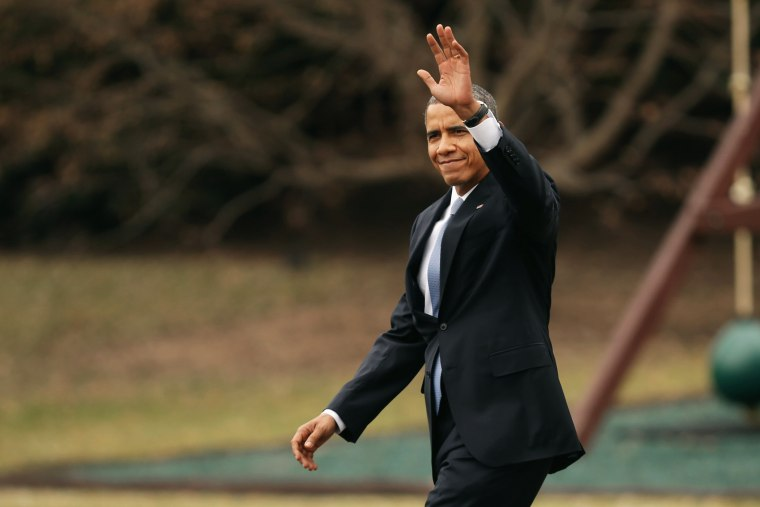 President Obama waves to guests as he walks across the South Lawn, March 11, 2014.