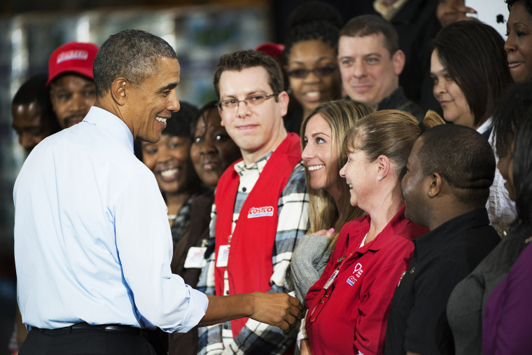 President Barack Obama greets Costco employees after his speech on the economy at a Costco Store Lanham, MD on Jan. 29, 2014.