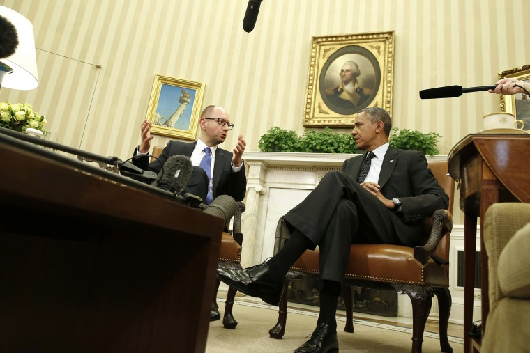 U.S. President Barack Obama listens as he hosts a meeting with Ukraine Prime Minister Arseniy Yatsenyuk (L) in the Oval Office of the White House in Washington on March 12, 2014.