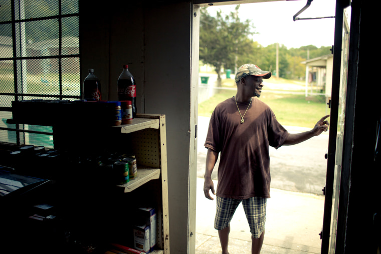 Curtis Parks stands outside The Corner Store, which he runs, on Hackett St. in Greenwood, S.C. on Sept. 28, 2012.