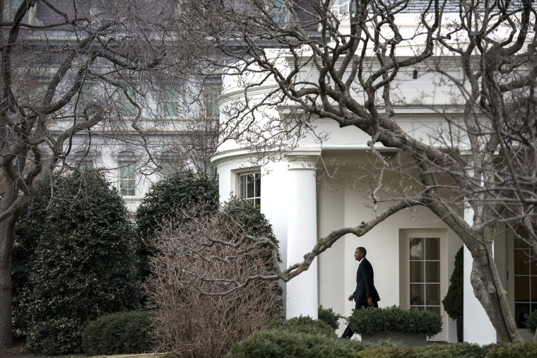 US President Barack Obama walks from the West Wing to Marine One on the South Lawn of the White House ob March 11, 2014 in Washington, DC.
