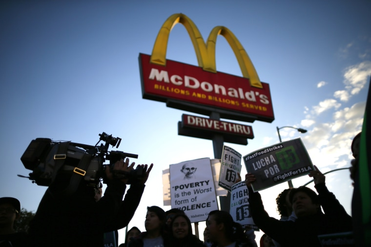 Protesters march outside McDonald's in Los Angeles